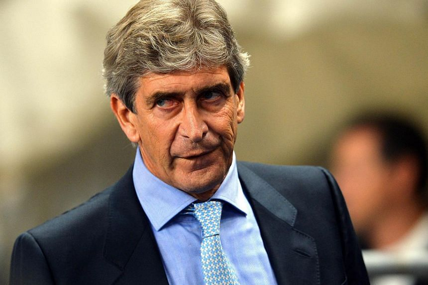 Manchester City's Chilean manager Manuel Pellegrini arrives for the Uefa Champions League group D football match between Manchester City and Bayern Munich in Manchester, north-west England, on Oct 2, 2013.Pellegrini has told his side they must