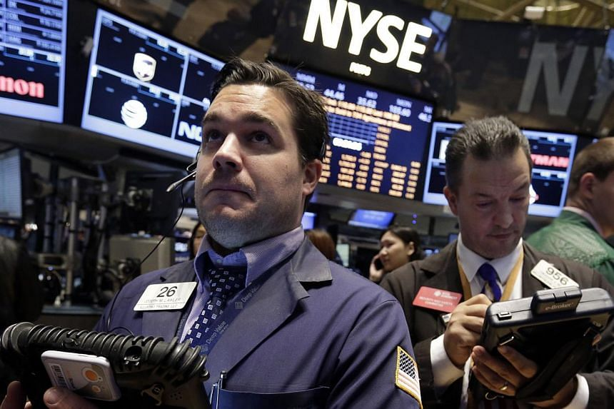 Joseph Lawler, left, works with fellow traders on the floor of the New York Stock Exchange, on Friday, Oct 18, 2013.The market was also relieved that Washington had reached a deal to end the fiscal stalemate. -- PHOTO: AP