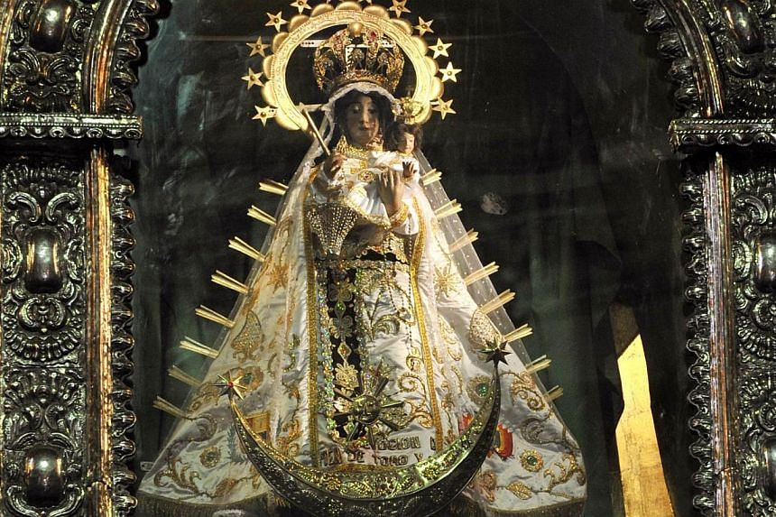 The image of the Virgin in the Our Lady of Copacabana sanctuary in Cobacabana, 135km from La Paz, on Sept 24, 2013.The Virgin of our Lady of Copacabana, known as the mother of the nation in Bolivia, has lost her golden crown - the latest religi