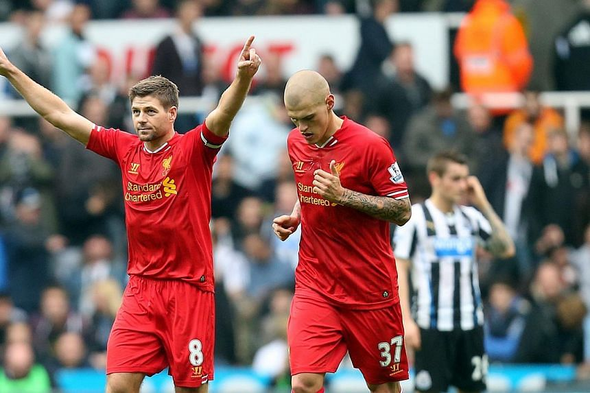 Liverpool's captain Steven Gerrard (left) celebrates his goal against Newcastle United at St James' Parkon Saturday, Oct 19, 2013. Liverpool inched to the top of the English Premier League table after twice coming from behind to earn a 2-2 draw at 10
