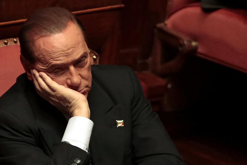 Former Italian prime minister Silvio Berlusconi attends a Senate meeting in Rome on Oct 2, 2013. A Milan court on Saturday, Oct 19, 2013, ruled that Berlusconi should be barred from holding public office for two years following a conviction for tax f