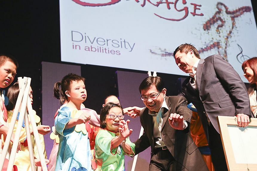 Education Minister Heng Swee Keat (third from right) temporarily turned actor on Friday night, participating in a performance with special education students during a concert. -- PHOTO: UBS