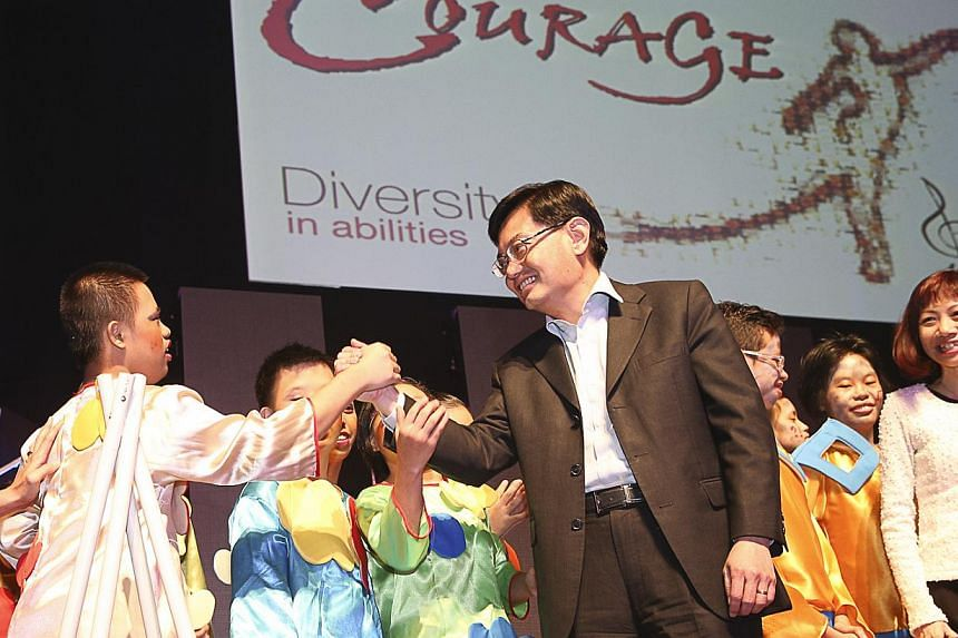 Education Minister Heng Swee Keat (centre) temporarily turned actor on Friday night, participating in a performance with special education students during a concert. -- PHOTO: UBS