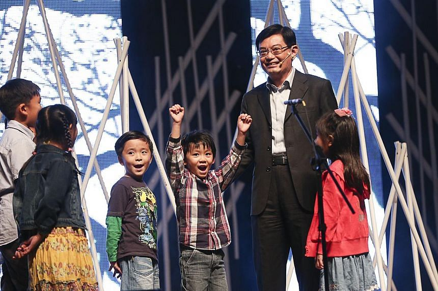 Education Minister Heng Swee Keat temporarily turned actor on Friday night, participating in a performance with special education students during a concert.-- PHOTO: UBS