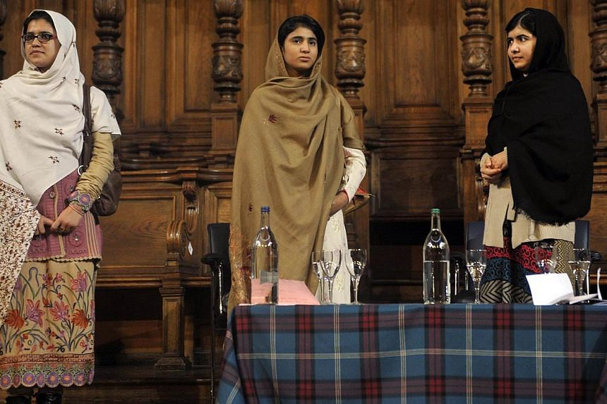 Malala Yousafzai (far right), the Pakistani girl shot by the Taleban after campaigning for girls' education, stands next to her school friends Kainat Riaz (far left) and Shazia Ramzan (centre) during the first Global Citizenship Commission meeting at