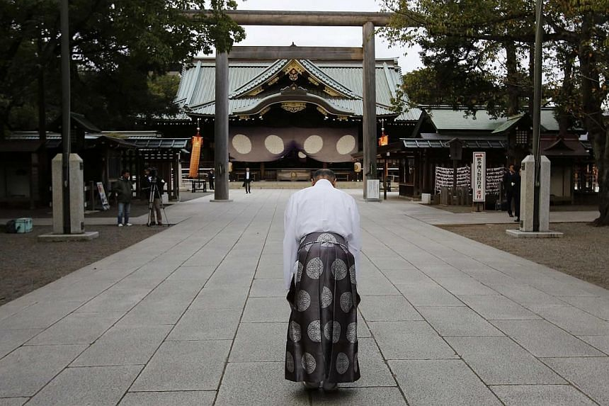 A Shinto priest bowing at the Yasukuni Shrine in Tokyo on October 18, 2013. -- FILE PHOTO: REUTERS