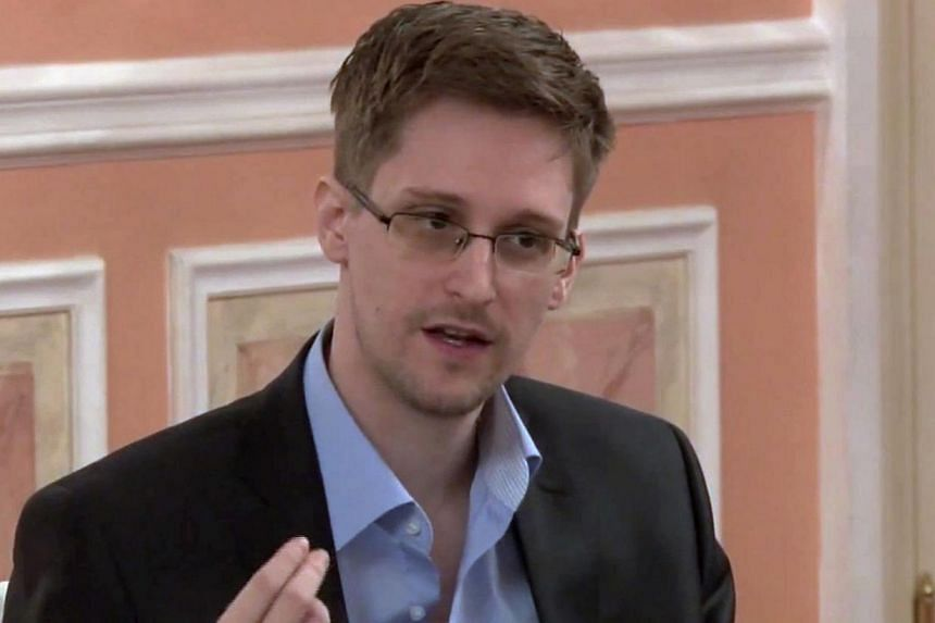 In this file image made from video released by WikiLeaks on Friday, Oct 11, 2013, former National Security Agency systems analyst Edward Snowden speaks during a presentation ceremony for the Sam Adams Award in Moscow, Russia. -- FILE PHOTO: AP