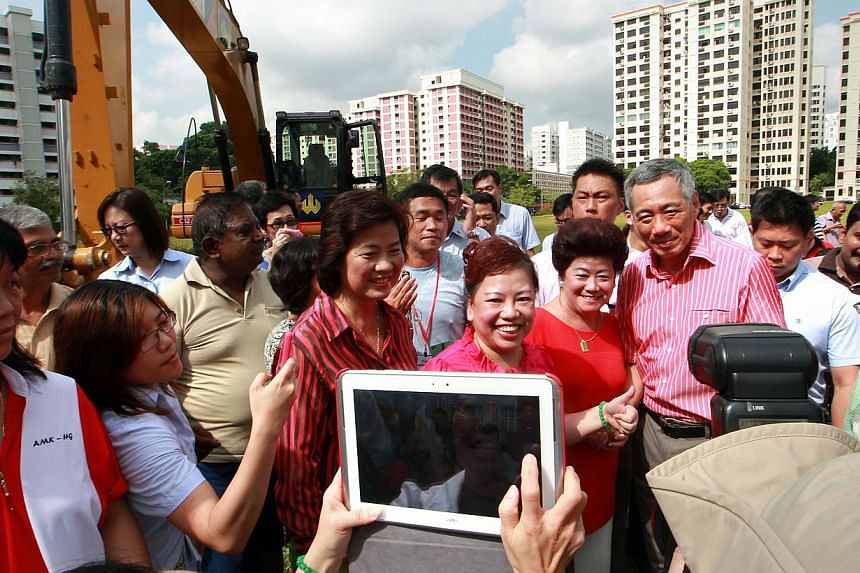 ...TO AIRIER GROUNDS: Prime Minister Lee Hsien Loong at the ground-breaking ceremony yesterday. At far right is Mr Yeo Guat Kwang. (Above) An artist's impression of the upcoming Ci Yuan Community Club. FROM KAMPUNG TO VOID DECK...  The Kebun Ubi Comm