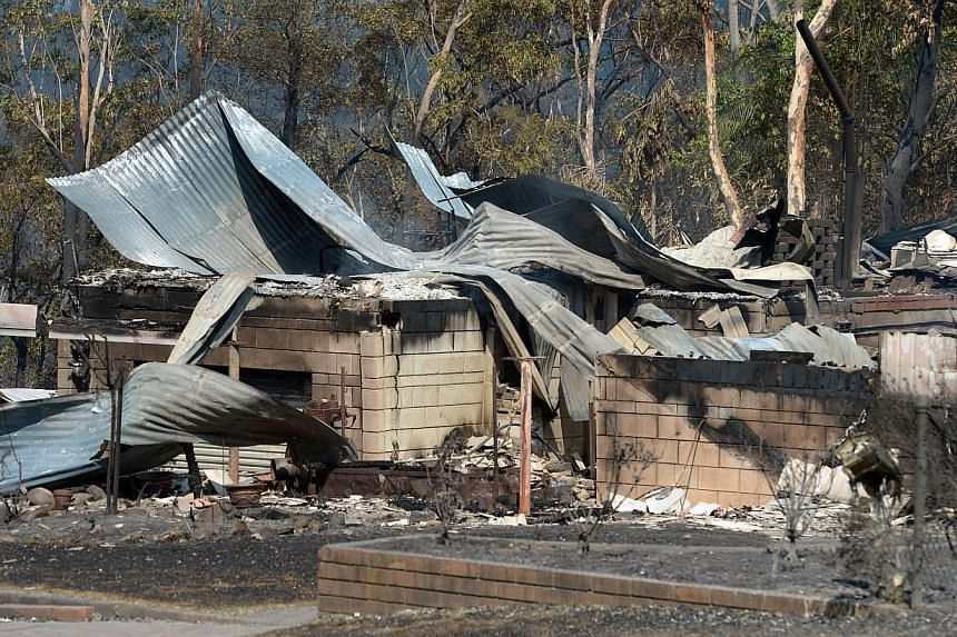 A house destroyed by bushfires is seen in Winmalee in Sydney's Blue Mountains on Friday, Oct 18, 2013. -- PHOTO: AFP