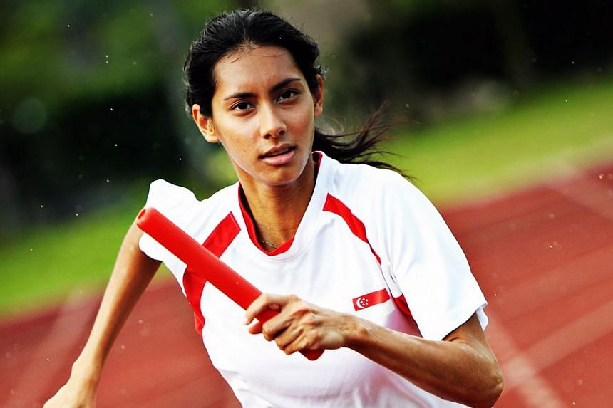 Singapore runner Dipna Lim-Prasad (above) has clocked a new national record in the 400m hurdles by timing 60.36 seconds for a bronze medal at the Malaysian Open Track and Field Championships in Kuala Lumpur. -- FILE PHOTO:HILL & KNOWLTON