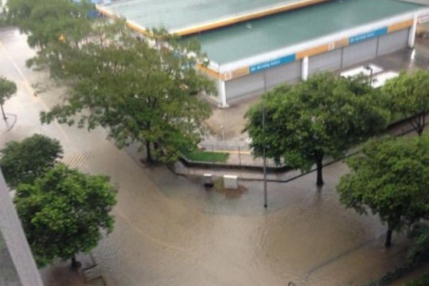 Heavy rain over the eastern and central parts of Singapore on Sunday afternoon led to flash floods. -- PHOTO: STOMP
