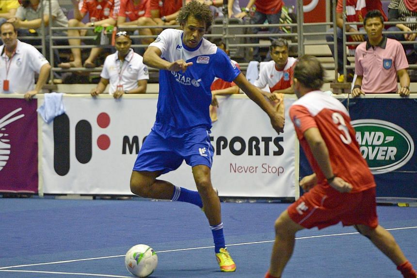 The EPL All Stars striker Pierre van Hooijdonk shapes to shoot past Singapore's Rafi Ali (No. 3) at the IG Masters Sixes at the Singapore Indoor Stadium on Sunday, Oct 20, 2013. -- ST PHOTO: DESMOND WEE