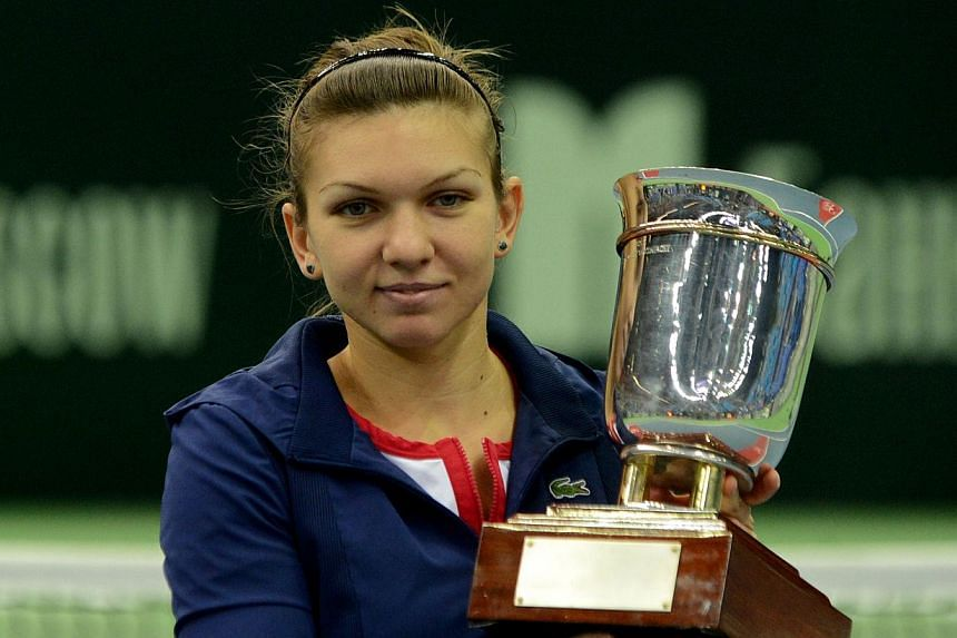 Romania's Simona Halep holds her trophy after her victory over Australia's Samantha Stosur in the Kremlin Cup tennis tournament final match in Moscow on Sunday, Oct 20, 2013. Halep's superb year continued on Sunday as she captured her fifth titl