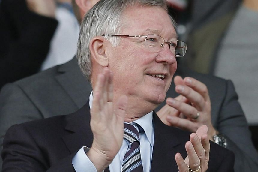 Manchester United former manager Alex Ferguson reacts during their English Premier League soccer match against Southampton at Old Trafford in Manchester, northern England, Oct 19, 2013. Ferguson told successor David Moyes that winning a trophy in his