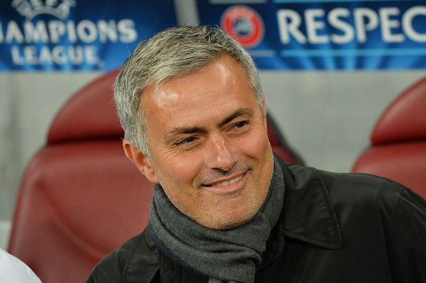 Chelsea's Portuguese manager Jose Mourinho attends the UEFA Champions League Group A football match Steaua Bucharest vs Chelsea FC at National Arena Stadium in Bucharest, Romania on Oct 1, 2013. A starstruck Chelsea supporter had an unexpected surpri