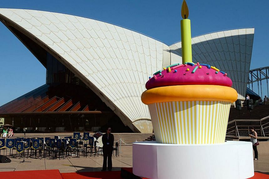"A giant birthday cup cake is displayed on the steps of the Sydney Opera House as the world heritage-listed building celebrates its 40th birthday on Oct 20, 2013. The Sydney Opera House, world heritage-listed as ""one of the indisputable masterpieces o"