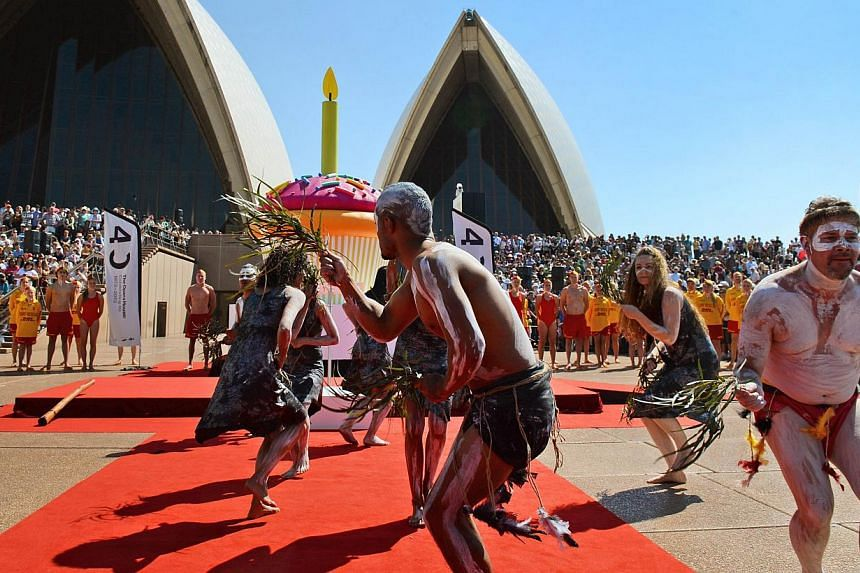 Aboriginal dancers perform a smoking ceremony on the steps of the Sydney Opera House as the world heritage-listed building celebrates its 40th birthday on Oct 20, 2013. -- PHOTO: AFP