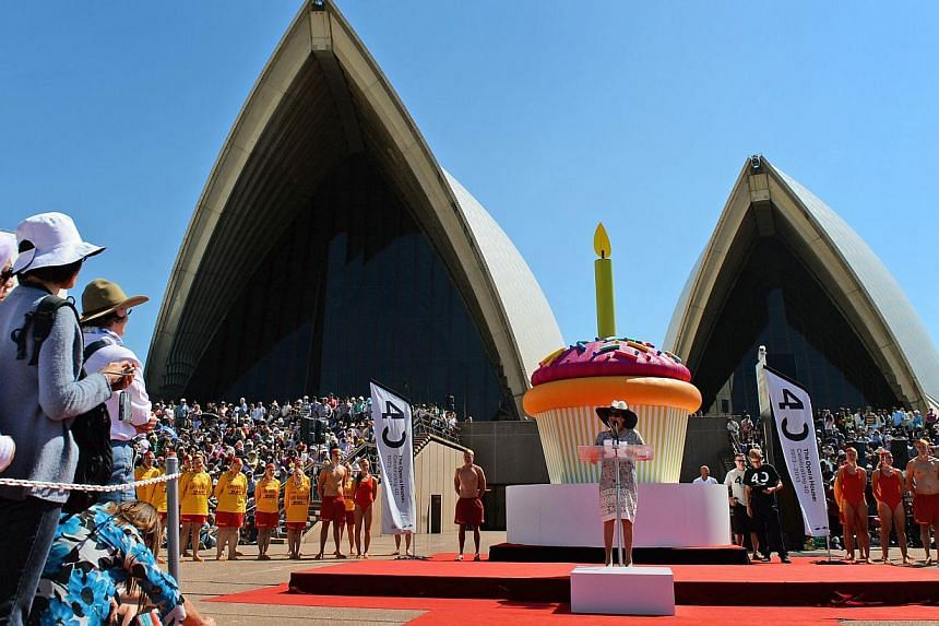 Governor of New South Wales, Marie Bashir (centre, right) speaks on the steps of the Sydney Opera House as the world heritage-listed building celebrates its 40th birthday on Oct 20, 2013. -- PHOTO: AFP