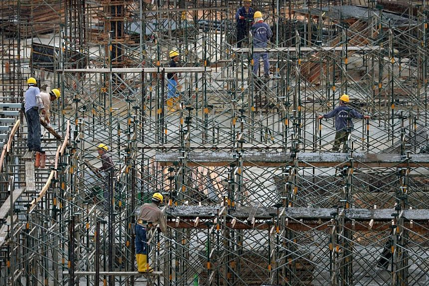 The construction boom shows no signs of ending any time soon, but a shortage of workers means projects may cost more and take longer to complete. -- ST FILE PHOTO: KUA CHEE SIONG