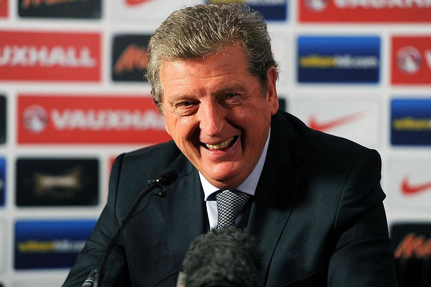 England coach Roy Hodgson speaks at a news conference in London, Oct 16, 2013. England manager Roy Hodgson has backed Wayne Rooney to put his major tournament disappointments behind him by becoming one of the stars of the 2014 World Cup. -- FILE PHOT