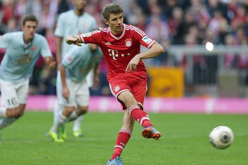 Bayern's Thomas Mueller scores a penalty during the German first division Bundesliga soccer match between FC Bayern Munich and FSV Mainz 05, in Munich, southern Germany, Saturday, Oct 19, 2013. Germany winger Thomas Mueller has confirmed reports he w