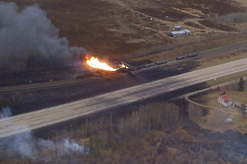 A train derailment in Gainford, Alberta is seen in this aerial photo courtesy of the RCMP and Parkland County, Oct 19, 2013. A train carrying crude oil and liquefied petroleum gas derailed west of Edmonton, Alberta, on Saturday, causing an explosion