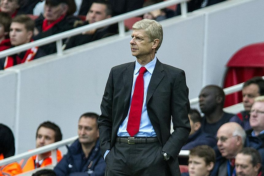 Arsenal's manager Arsene Wenger looks on during their English Premier League soccer match against Norwich City, at the Emirates Stadium, in London, Saturday, Oct. 19, 2013. -- PHOTO: AP