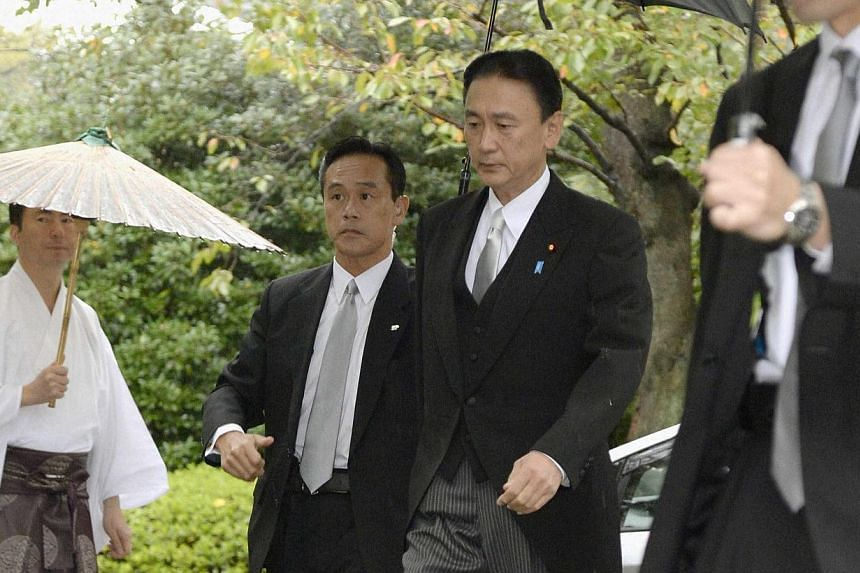 Japan's Minister-in-Charge of the Abduction Issue and head of the national public safety commission Keiji Furuya (right) arrives at the Yasukuni Shrine in Tokyo, Oct 20, 2013. A second Japanese Cabinet minister visited a controversial war shrine in T