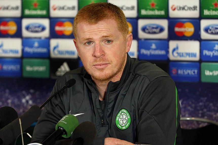 Celtic's Northern Irish manager Neil Lennon speaks at a press conference at Celtic Park, Glasgow, Scotland, on Sept 30, 2013 ahead of their Uefa Champions League last sixteen football match against Barcelona on Oct 1st. The Glasgow giants reache