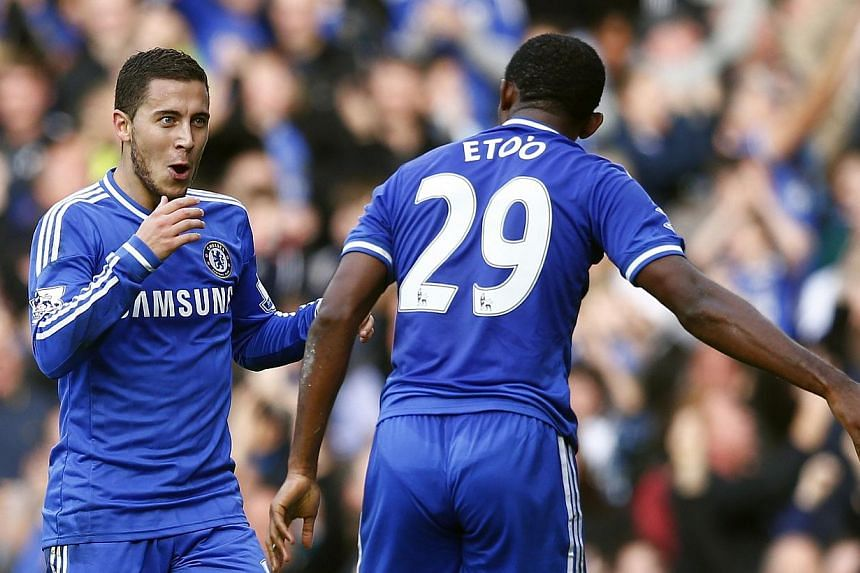 Chelsea's Eden Hazard celebrates with Samuel Eto'o (right) after scoring against Cardiff City during their English Premier League soccer match at Stamford Bridge in London, October 19, 2013. Chelsea goalkeeper Petr Cech claims referee Anthony Ta