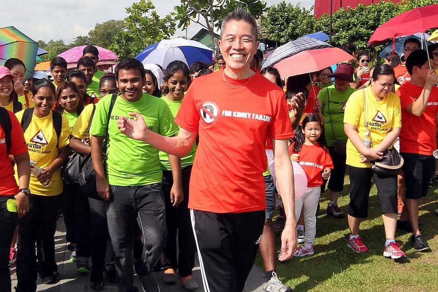 Mr Edmund Kwok (centre) with National Kidney Foundation employees at a healthy lifestyle walk organised for the staff. Mr Kwok, who is the charity's current chief operating officer, will succeed Mrs Eunice Tay as its chief executive on Nov 1. -- ST