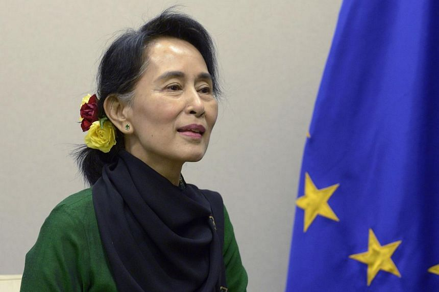 Myanmar opposition leader Aung San Suu Kyi (above) on Monday, Oct 21, 2013, urged European Union and world leaders to pile pressure on her country's government to complete its reform process. -- PHOTO: REUTERS