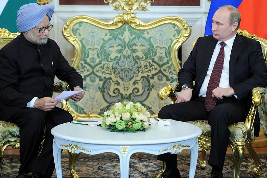 Russia's President Vladimir Putin (right) and Indian Prime Minister Manmohan Singh meet in the Kremlin in Moscow on Monday, Oct 21, 2013. Mr Singh met Mr Putin on Monday amid signs that the two giants had failed to reach a breakthrough on a long