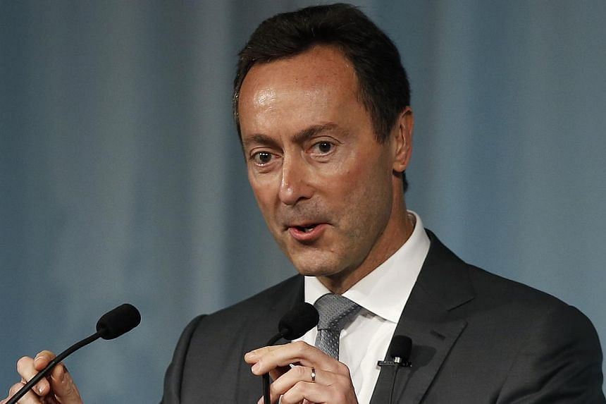 Airbus President and Chief Executive Officer Fabrice Bregier adjusts the microphones as he delivers a speech at the Global Management Forum in Tokyo on Oct 21, 2013. Airbus chief executive Fabrice Bregier said on Monday that politics in Japan can inf