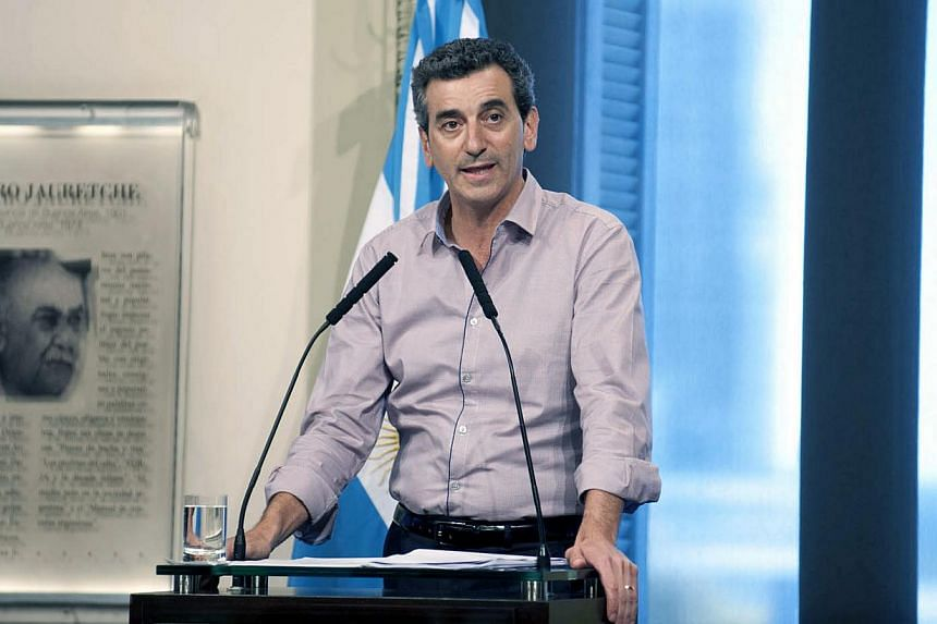 Argentinian Transport Minister Florencio Randazzo delivers a spress conference in Buenos Aires on Oct 19, 2013, after a train failed to stop and crashed at the end of the line at the Once railway terminal. -- PHOTO: AFP
