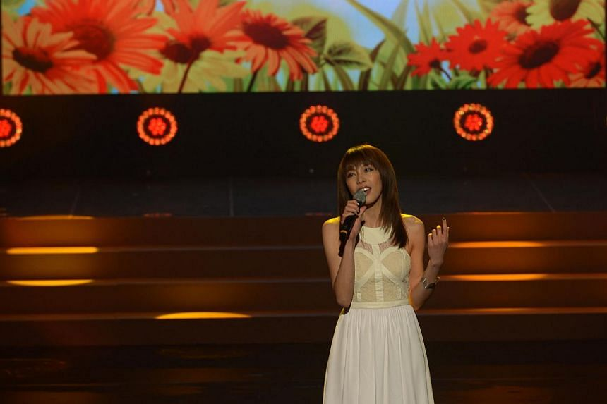 Singer Olivia Ong performs at the President Star's Charity Show. --ST PHOTO: NG SOR LUAN