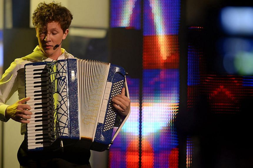 Lithuanian accordionist Martynas Levickis performing at the President Star's Charity Show. --ST PHOTO: NG SOR LUAN