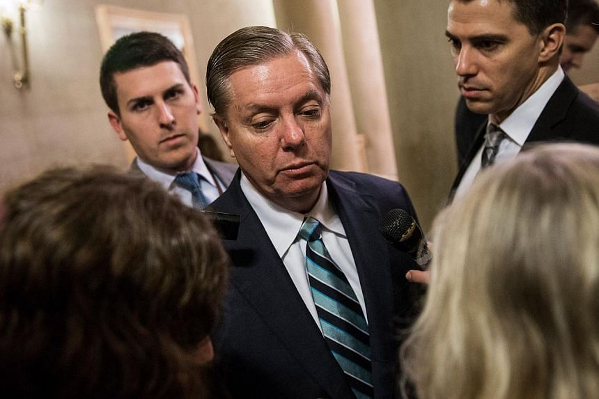 Senator Lindsey Graham answers questions as he arrives for a meeting of Senate Republicans on a solution for the pending budget and debt limit impasse at the US Capitol Oct 16, 2013 in Washington, DC. A dour Mr Graham told CBS television that it is a