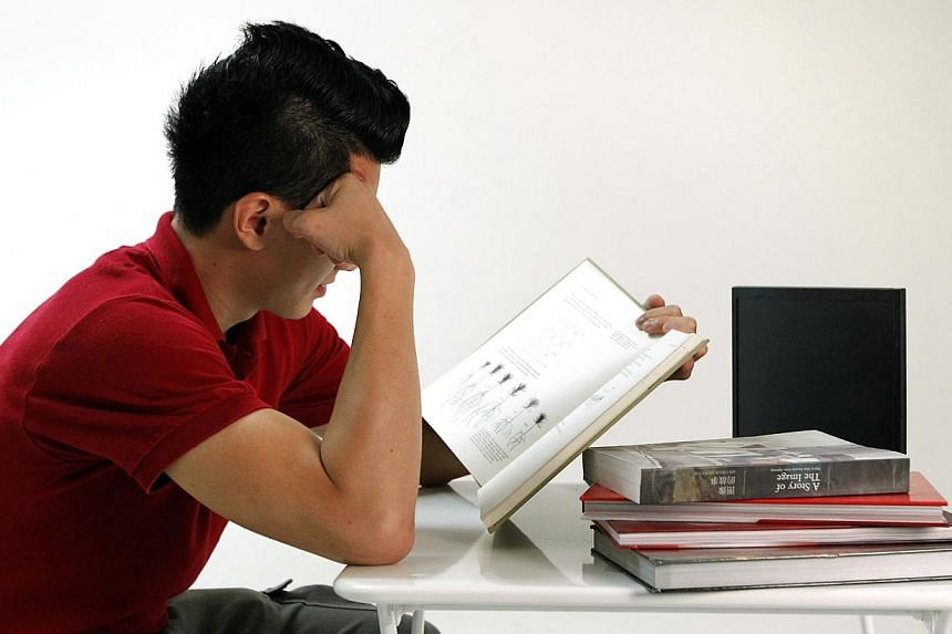 Posed photo of a university student studying. Students are mimicking ADHD symptoms in a bid to get their hands on a drug that can help them improve their concentration. -- ST FILE PHOTO: KEVIN LIM