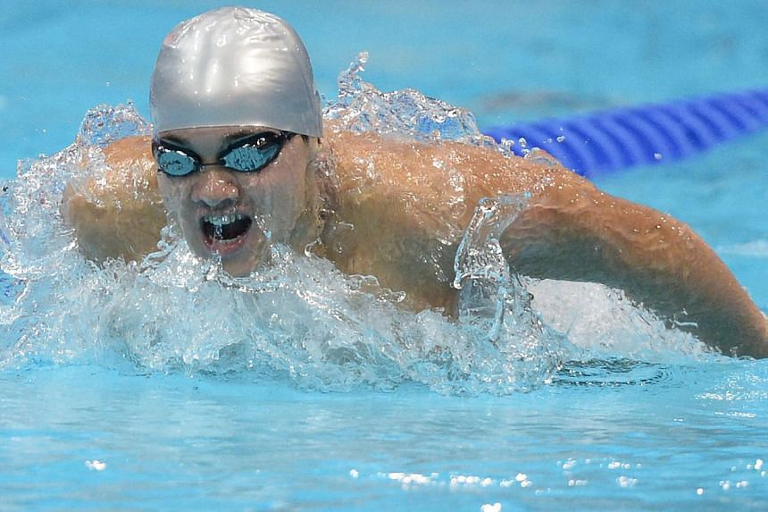 Singaporean swimmer Joseph Schooling competes in the men's 200m butterfly heat of the London Olympics held on July 30, 2012 at the Aquatics Centre in London, UK.-- ST FILE PHOTO: MUGILAN RAJASEGERAN