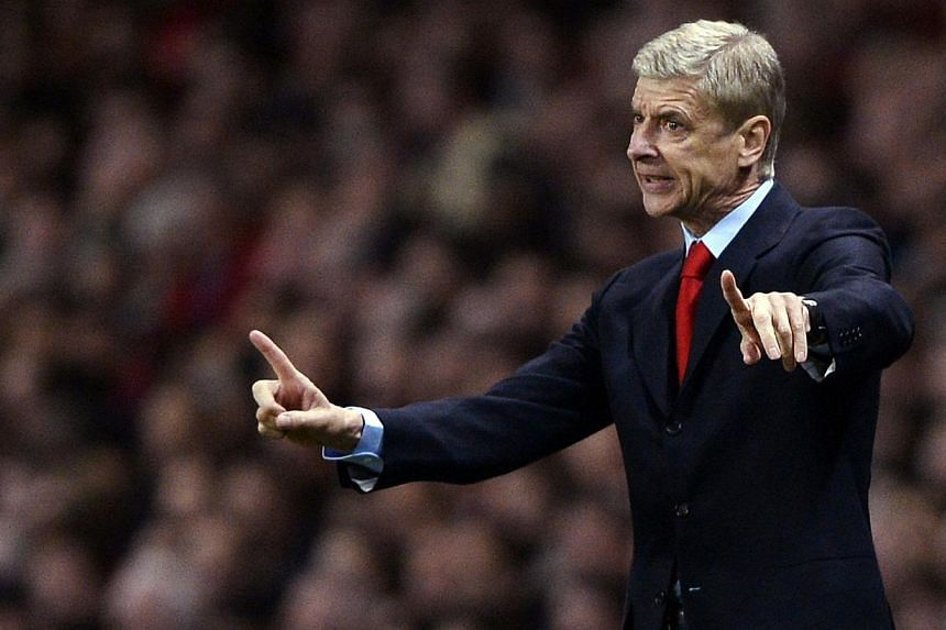 "Arsenal's manager Arsene Wenger reacts during their Champions League soccer match against Napoli at the Emirates stadium in London on Oct 1, 2013. Arsene Wenger believes Arsenal's Champions League double-header against Borussia Dortmund will be ""deci"