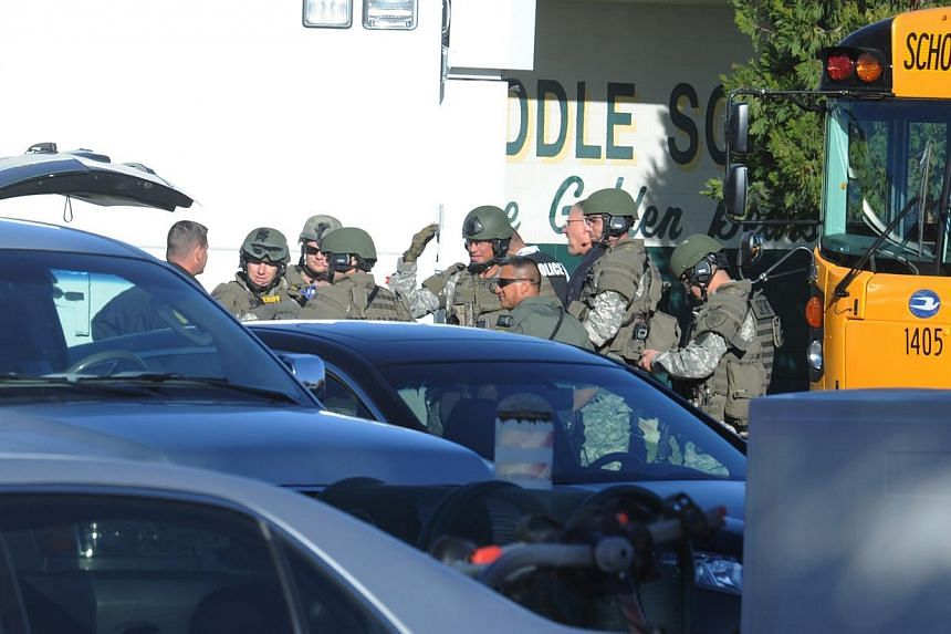 Police officers are at the shooting scene at the Sparks Middle School in Sparks, Nevada, on Oct 21, 2013. A teenager opened fire at a school in the United States (US) state of Nevada on Monday, killing a teacher and critically wounding two students,