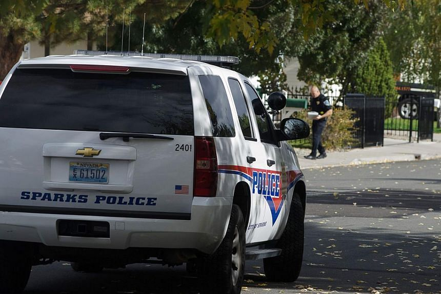 Sparks police secure the scene of a shooting on Woodhaven Lane in Sparks, Nevada on Oct 21, 2013. A teenager opened fire at a school in the United States (US) state of Nevada on Monday, killing a teacher and critically wounding two students, police a