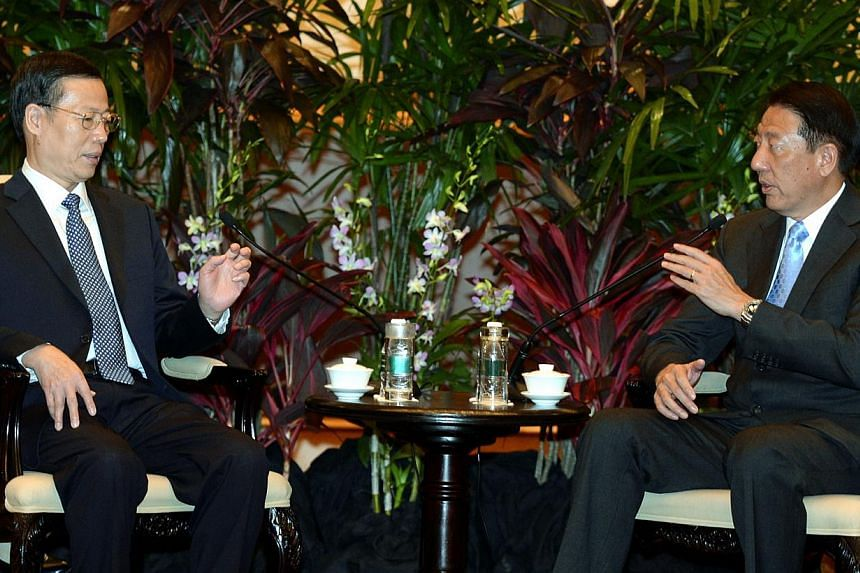 Visiting Chinese Vice-Premier Zhang Gaoli (left) meets with Deputy Prime Minister Teo Chee Hean on Monday, Oct 21, 2013.Singapore and China have agreed on new initiatives to strengthen cooperation on financial sector development and regulation.