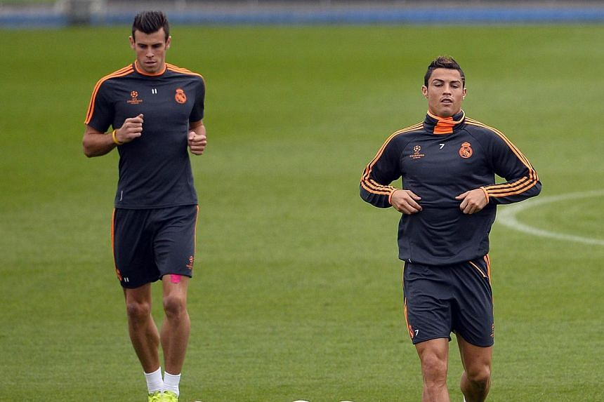 Real Madrid's Portuguese forward Cristiano Ronaldo (right) and Real Madrid's Welsh striker Gareth Bale run during a training session at the Valdebebas training ground on Tuesday, Oct 22, 2013.Ronaldo knows a thing or two about high expectations