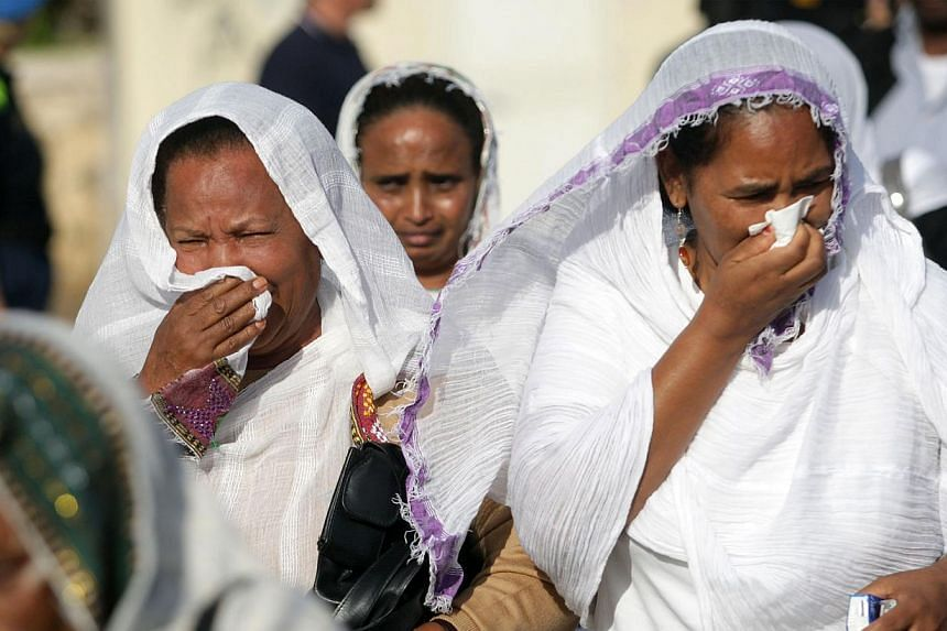 Women weep on Oct 21, 2013 in the southern Sicilian city of Agrigento during a ceremony commemorating the migrants who drowned off the southern Italian islad of Lampedusa. -- PHOTO: AFP