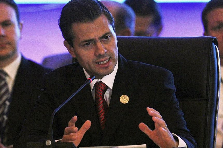 Mexican President Enrique Pena Nieto speaks during the XXIII Ibero-American Summit, in Panama City, on Oct 19, 2013.Mexico has ordered an investigation into allegations the United States spied on both President Enrique Pena Nieto before his ele