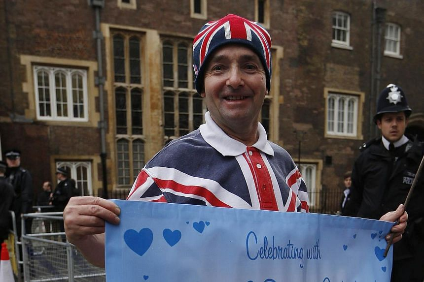 Royal supporter John Loughrey poses outside the Chapel Royal, St James's Palace in London ahead of the christening of Prince George, Tuesday, Oct 22, 2013. -- PHOTO: AP
