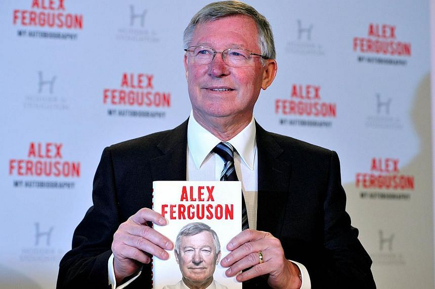 "Former Manchester United manager Alex Ferguson poses with a copy of his autobiography titled ""My Autobiography"" during a press conference to mark the launch of the book in central London on October 22, 2013. Former Manchester United captain Roy"