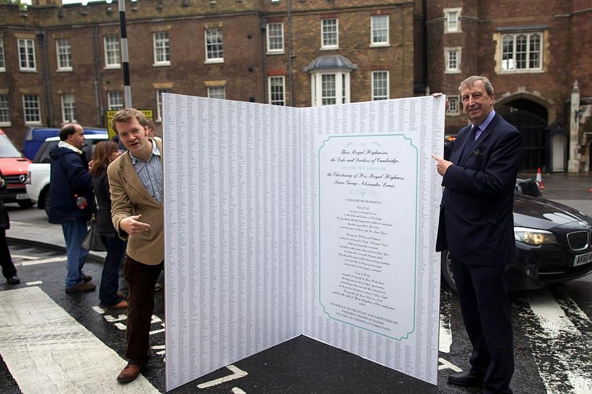 A giant Christening card is pictured before delivery outside the Royal Chapel in St James's Palace in Central London on Oct 22, 2013, where Prince George of Cambridge will be baptised. -- PHOTO: AFP